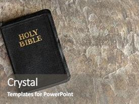 Cool new presentation theme with old bible closed top view backdrop and a gray colored foreground.
