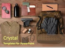 Theme having overhead view of hiking gear background and a tawny brown colored foreground