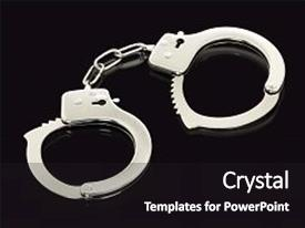 Slides enhanced with crime - pair of handcuffs isolated background and a black colored foreground