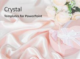 Cool new presentation theme with pink camellia flowers and two gift boxes in the shape of heart with white bow on background of pink silk fabric with copy-space backdrop and a light gray colored foreground.