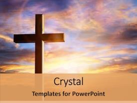 PPT theme featuring religious - crucifix cross at sunset background background and a yellow colored foreground