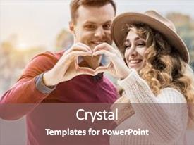 Slides consisting of showing symbol of love closeup young man and beautiful woman in hat keeping their hands together in form of heart sign loving couple made heart shape with their hands love and togetherness concept background and a violet colored foreground.