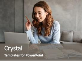 PPT theme featuring table with laptop computer background and a gray colored foreground