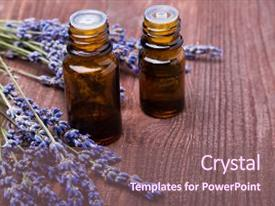 Audience pleasing presentation theme consisting of two bottles of aroma oils backdrop and a  colored foreground.