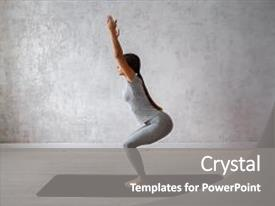 Amazing PPT theme having woman practicing advanced yoga backdrop and a gray colored foreground.