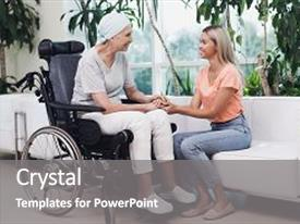 PPT theme enhanced with woman with cancer is sitting in a wheelchair next to her sits her daughter on a white sofa a woman is happy to see her daughter they are in the clinic the woman tells that she is recovering background and a gray colored foreground.