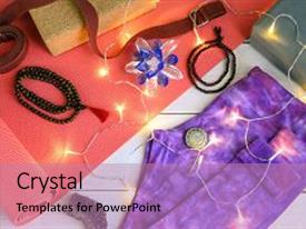 Slides consisting of yogi accessories yoga mat yoga pants strap and block mala beads ayurveda solid perfume healing crystal with christmas garland yoga christmas gift background background and a coral colored foreground.