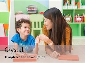 Presentation having young asian woman teacher teaching american kid in kindergarten classroom with happiness and relaxation education elementary school learning and people concept - teacher help school kids classroom background and a light gray colored foreground.