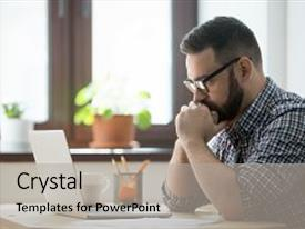 Cool new presentation design with young bearded manager working and reading data on laptop in home office thoughtful casual businessman thinking about job and looking on screen of notebook backdrop and a light gray colored foreground.