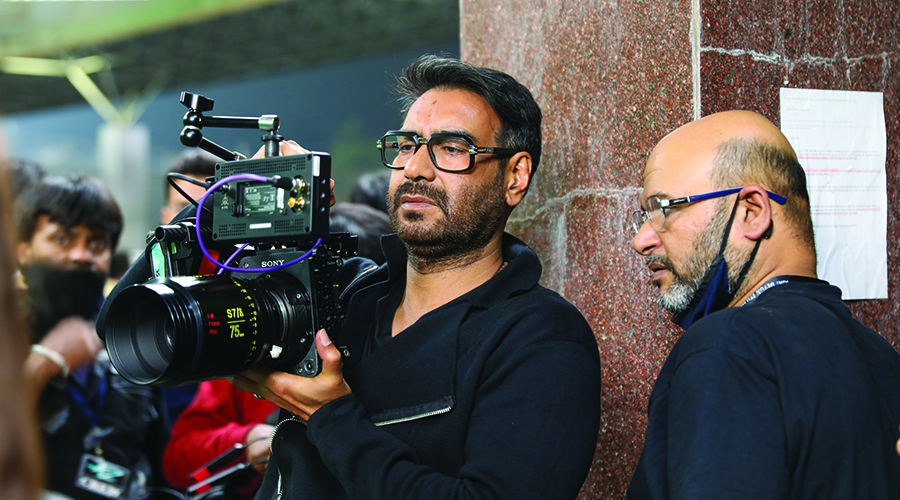 Director and lead actor Ajay Devgn and DoP Aseem Bajaj examine a shot on the VENICE with Rialto extension on the set of Mayday which also stars Amitabh Bachchan.