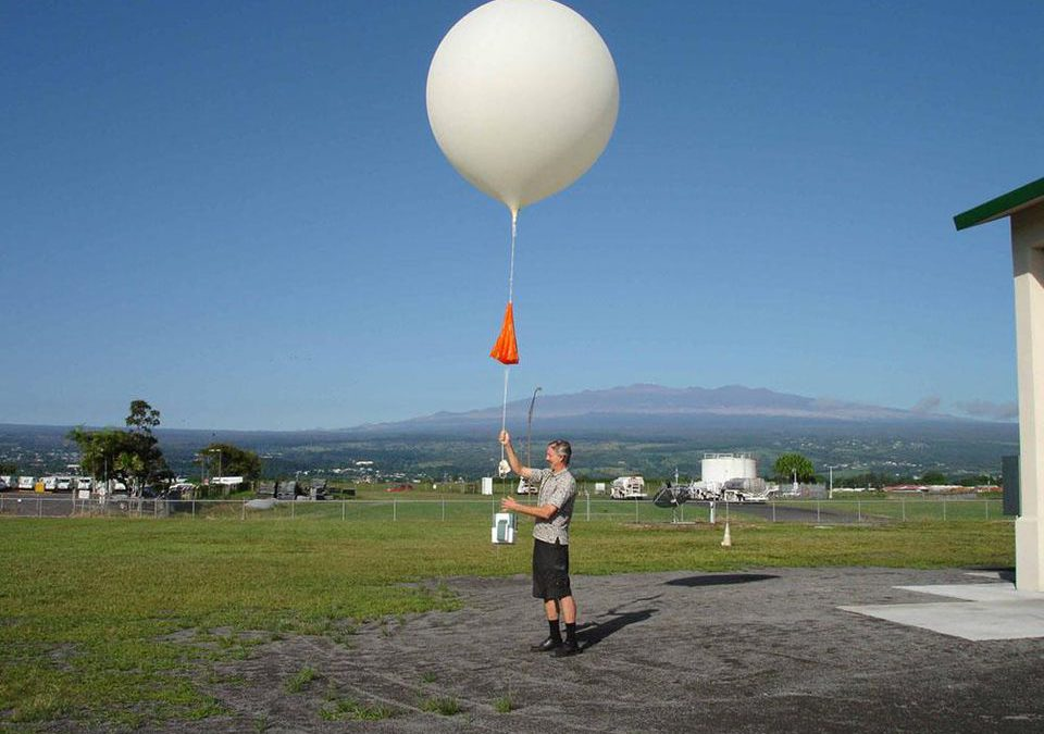 NWS weather balloon launch with field NOAA