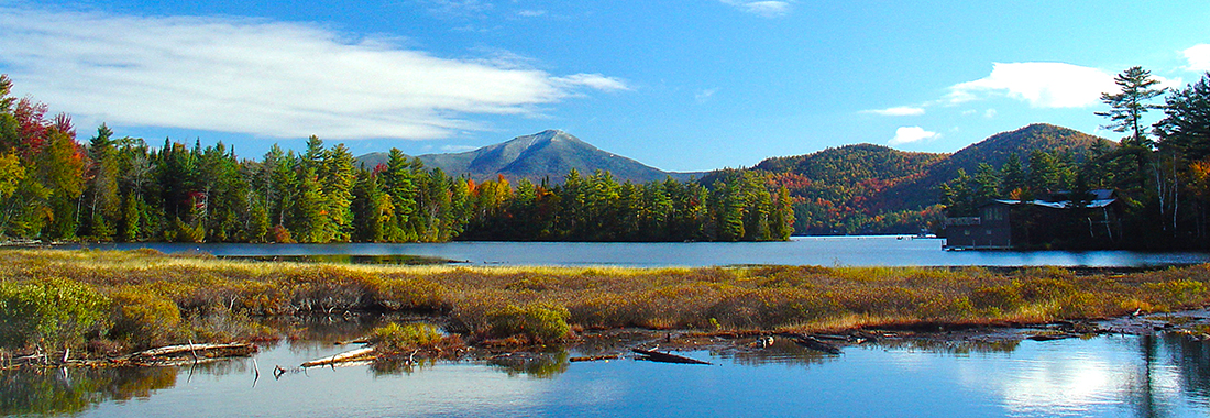 Royal Holiday - Stretch your legs at New York's Lake Placid - Enjoy unlimited outdoor activities surrounded by mountains.