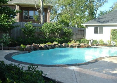 Pool-countersunk-natural-rock-weeping-wall-stamped-decking