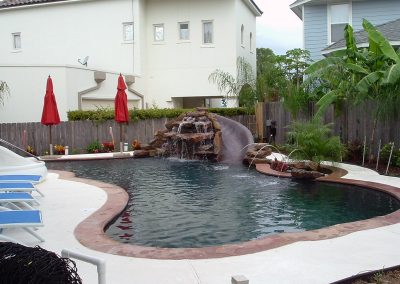 Pool-natural-rock-waterfall-slide-planter-with-jet-fountains-pebble-interior-finish