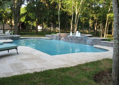 Pool-spa-waterfountain-and-waterfall-travertine-decking