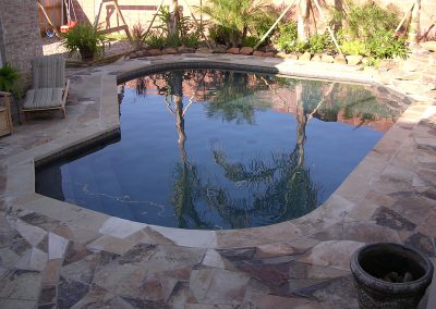 Pool-flagstone-decking-pebble-interior-finish
