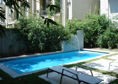 Pool-raised-beam-with-fountain