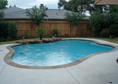 Pool-with-countersunk-natural-rock-weeping-wall-brushed-concrete-decking-3M-interior-finish