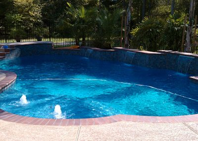 Pool-with-multi-teared-raised-beam-and-raised-acrylic-texture-decking-sheer-descent-waterfeatures