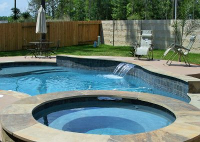 Pool-with-raised-spa-raised-wall-raised-deck-scupper-and-tanning-ledge