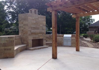 outdoor-fireplace-with-benches-outdoor-kitchen-pergola-and-walkway