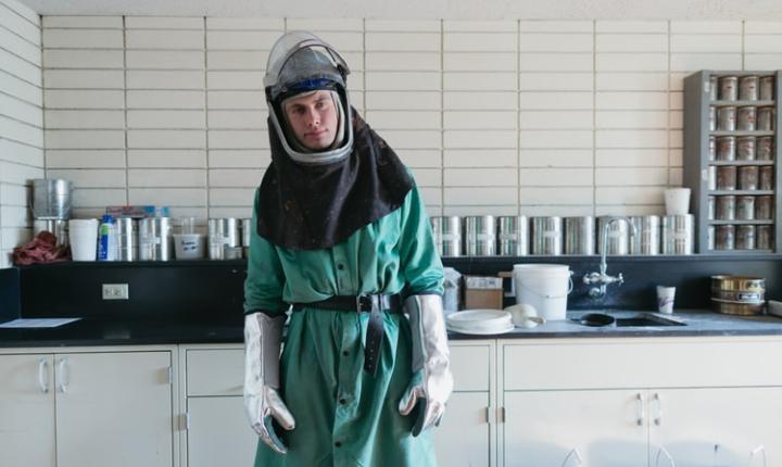 Man in hazardous materials suit