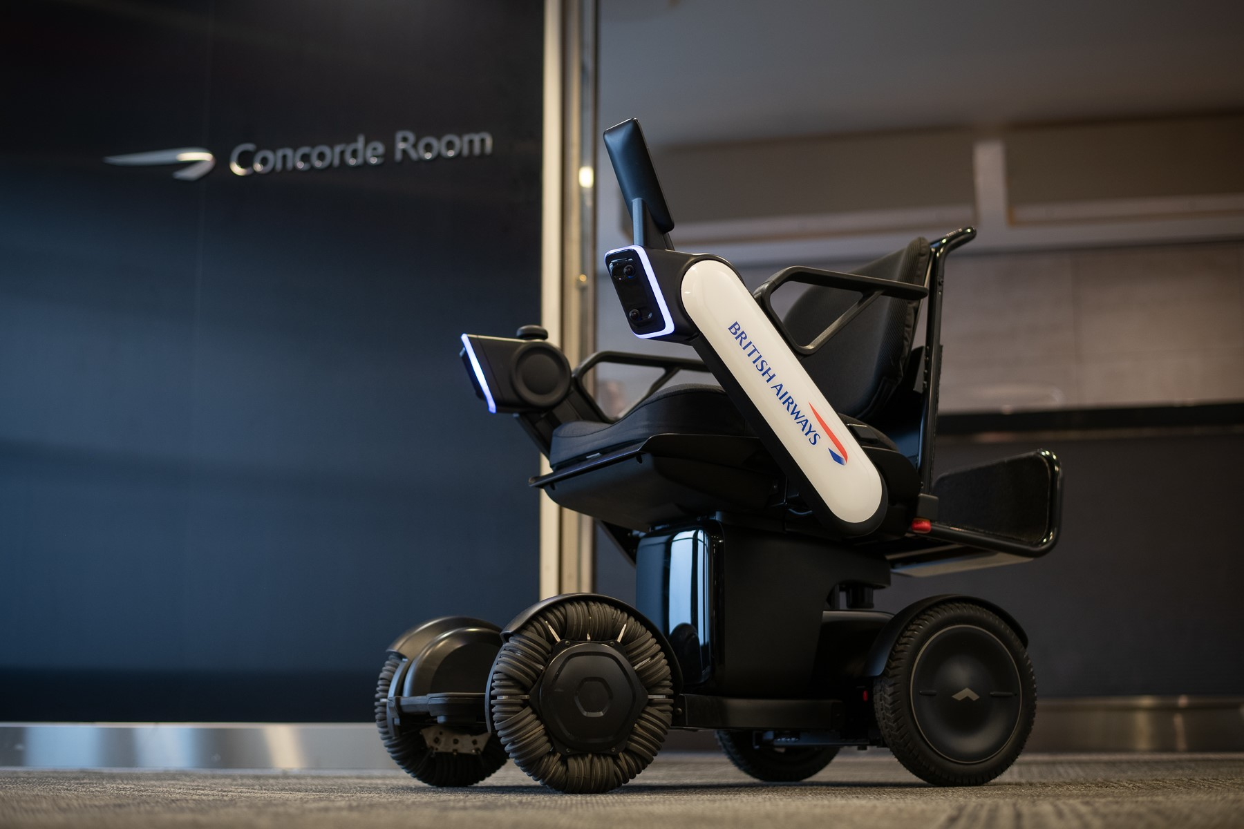 WHILL Model Ci autonomous wheelchair with British Airways branding.