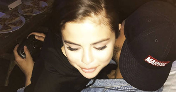 Selena Gomez and The Weeknd Cuddle as He Plays Video Games