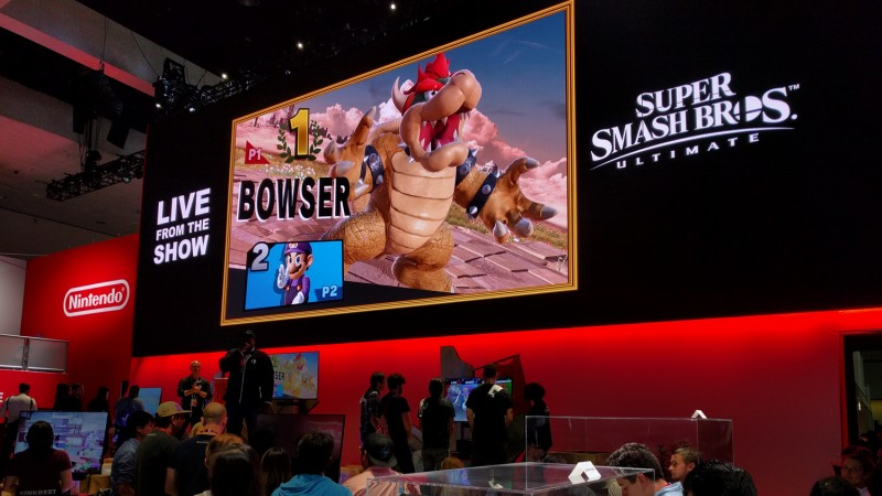 Just kidding! SSBU is impossible to miss at Nintendo's booth, just like it's impossible not to be creeped out by Mario wearing Waluigi's clothes. Seriously, how did he even get a hold of those?