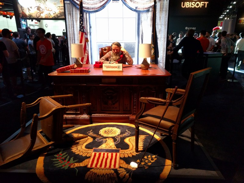 "According to Ubisoft, The Division 2 is not a political game – which is why they have a set of the oval office at their booth. Within 30 seconds of sitting down Cork was yelling ""Yeh fired!"" at everyone who walked past. Talk about power hungry..."