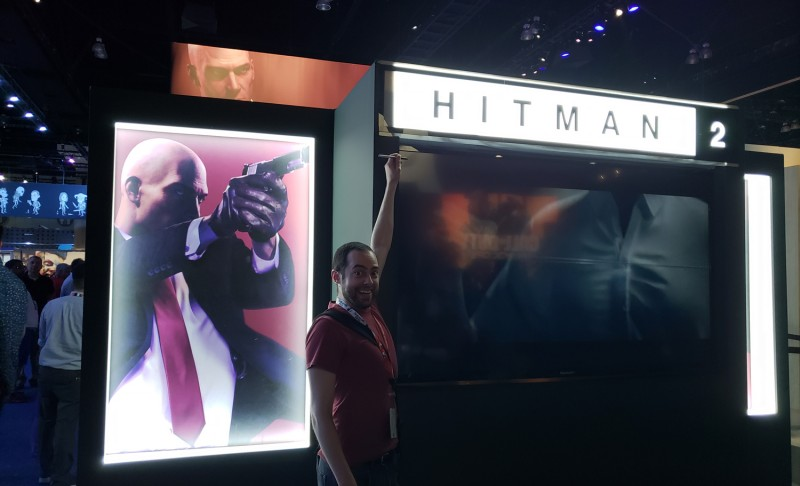 "Here's me trying my best to draw an ""S"" on the Hitman 2 display, only I was too short to pull it off. Dangit, I knew I should've brought my prank stool to E3!"