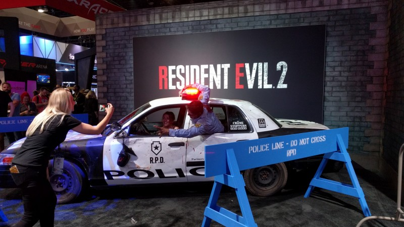 Capcom also has a police car you can sit in and get mauled by a zombie cop while your friend laughs and takes pictures of you. What are you doing, lady? Help her!