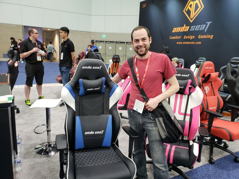 Here I am posing with the most popular Twitch streamer of them all: the blue gaming chair! Talk about an influencer!