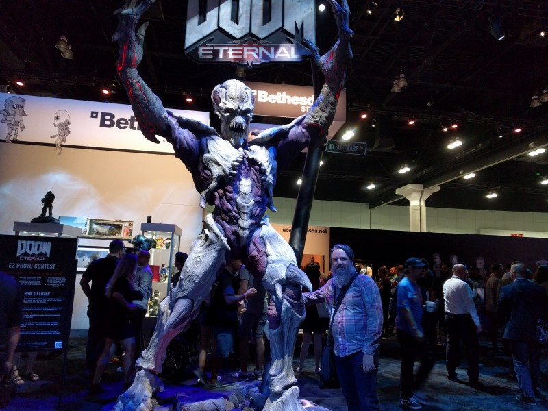 Next we headed to Bethesda's booth, which featured a giant statue for Doom Eternal. Notice Cork's expert hover hand technique – clearly he's taken pictures with demons before.