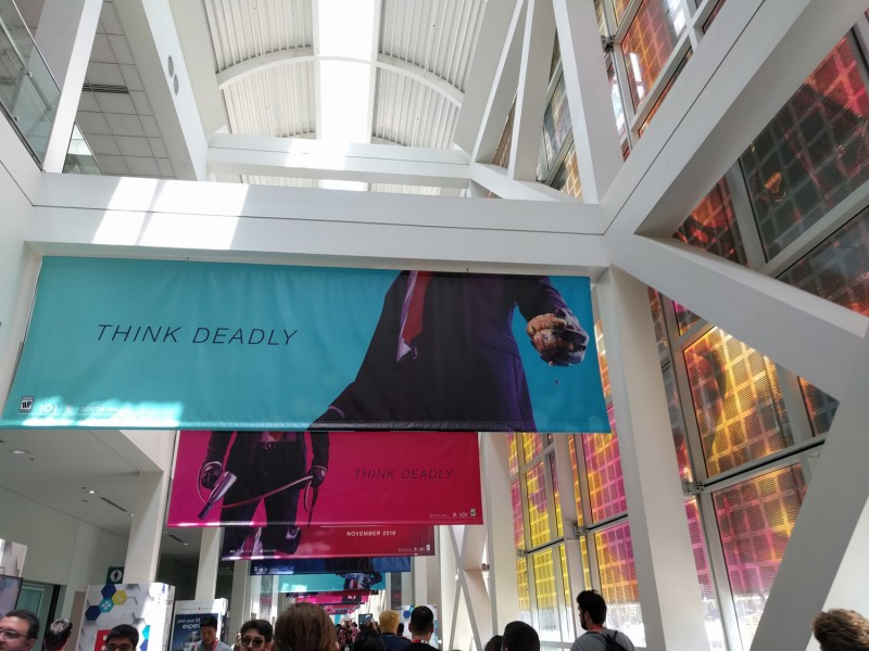 Hitman 2 has a long line of banners running down the main hallway. How the heck is 47 going to kill someone with that muffin?!