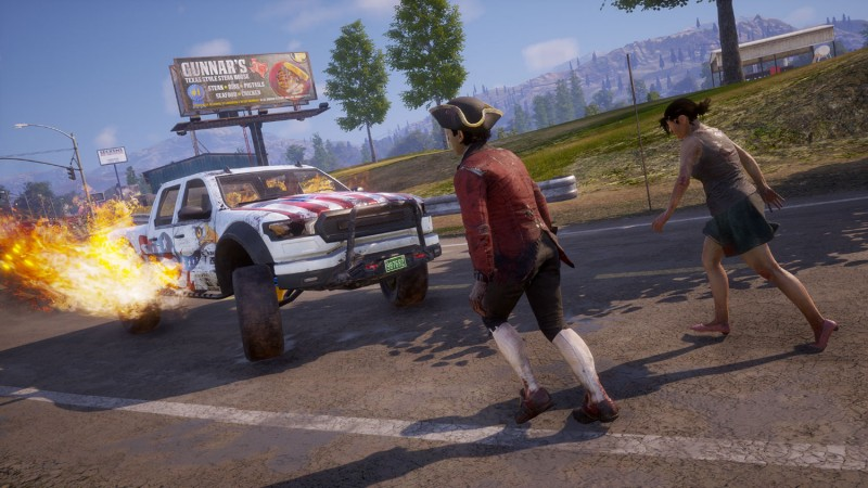 A zombie in a tricorn hat is about to get creamed by a red, white, and blue truck.