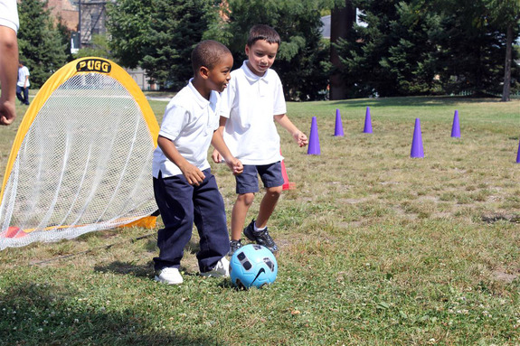Research shows that physical activity boosts academic success. Here, students get active playing soccer at school.