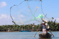Vietnamese fisherman with net   1