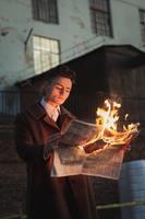 Man reading burning newspaper 3278364 (1)