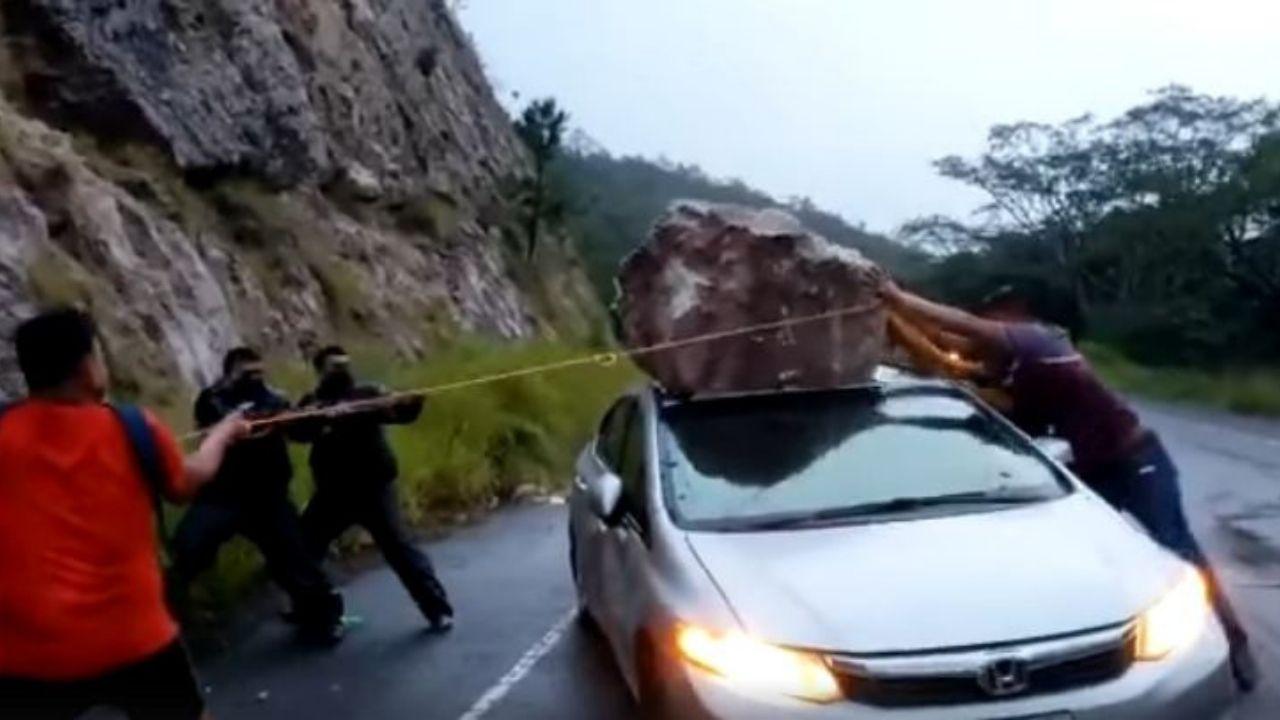 Hondureño se salva de morir aplastado luego que cayera una roca enorme en su carro, aquí el vídeo