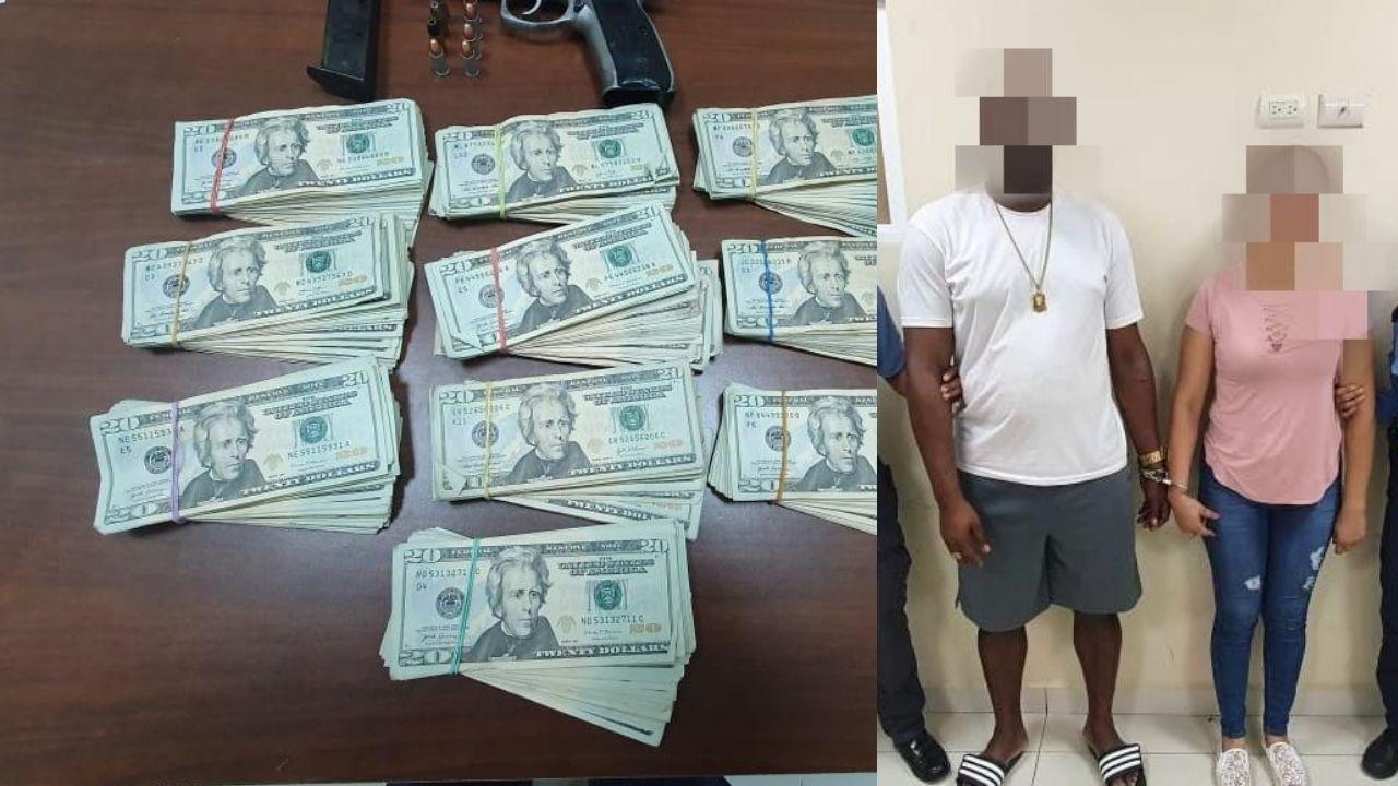 Capturan a pareja en posesión de 20 mil dólares y una arma de fuego en Roatán