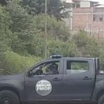 carro policia militar en escena del crimen en honduras