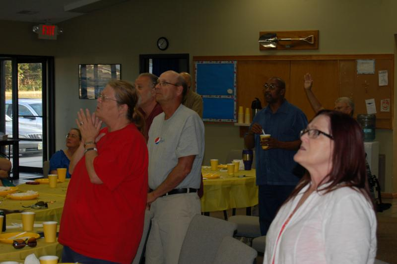 Members of Northern Lighthouse CRC join together in worship.