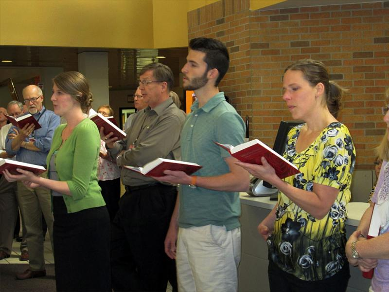 Staff and members of the board held an impromptu hymn sing to celebrate the arrival of the new hymnal.