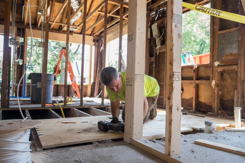 Rob Lach works on the Sabec brothers' home.