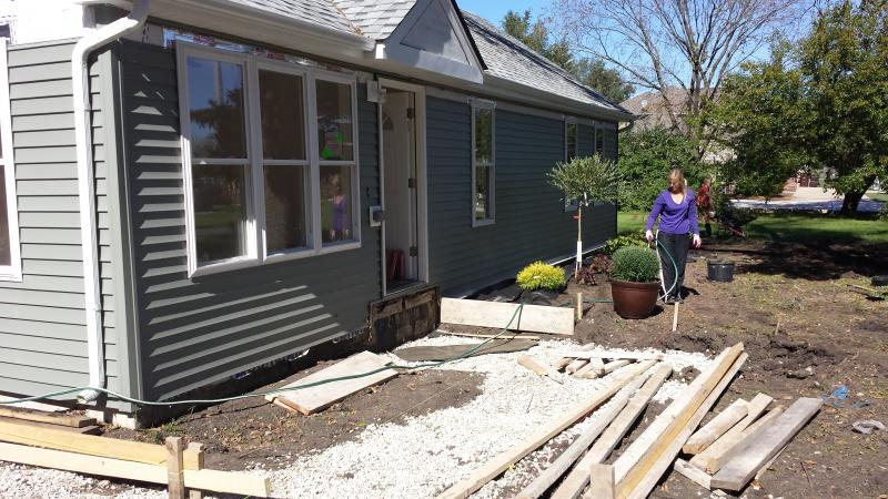 With the interior and exterior well underway, volunteers landscape the Sabec brothers' home