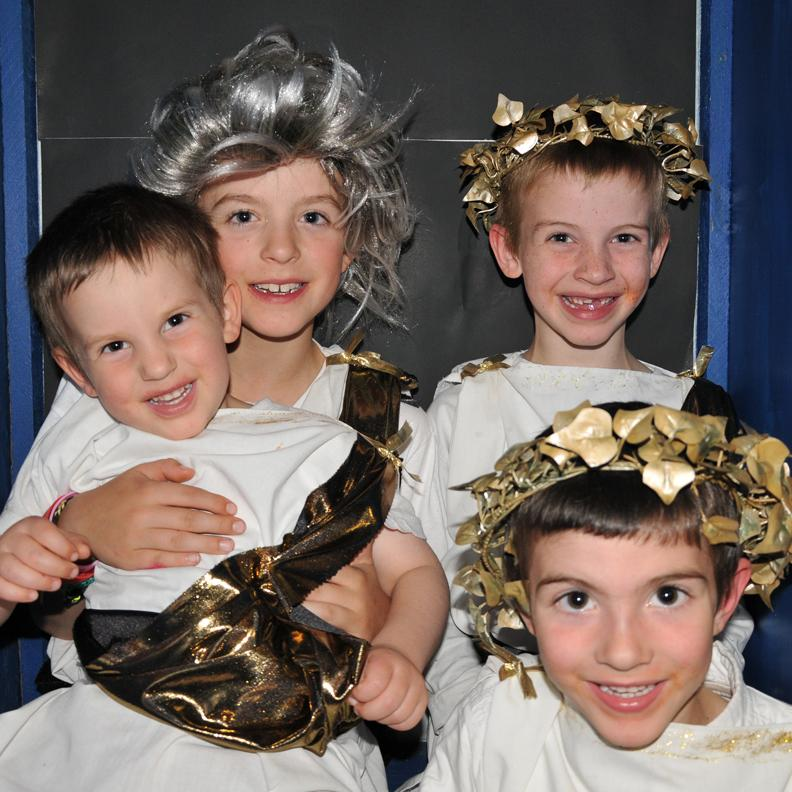 Four children dressed as Ceasar.