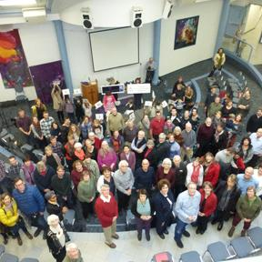 Members of Fellowship CRC in Edmonton rally to celebrate the survival of KAIROS.