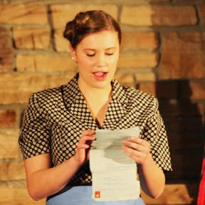 Main character Ina, played by Jocelyn VanDyke, receives a letter from her fiancé, Rein.