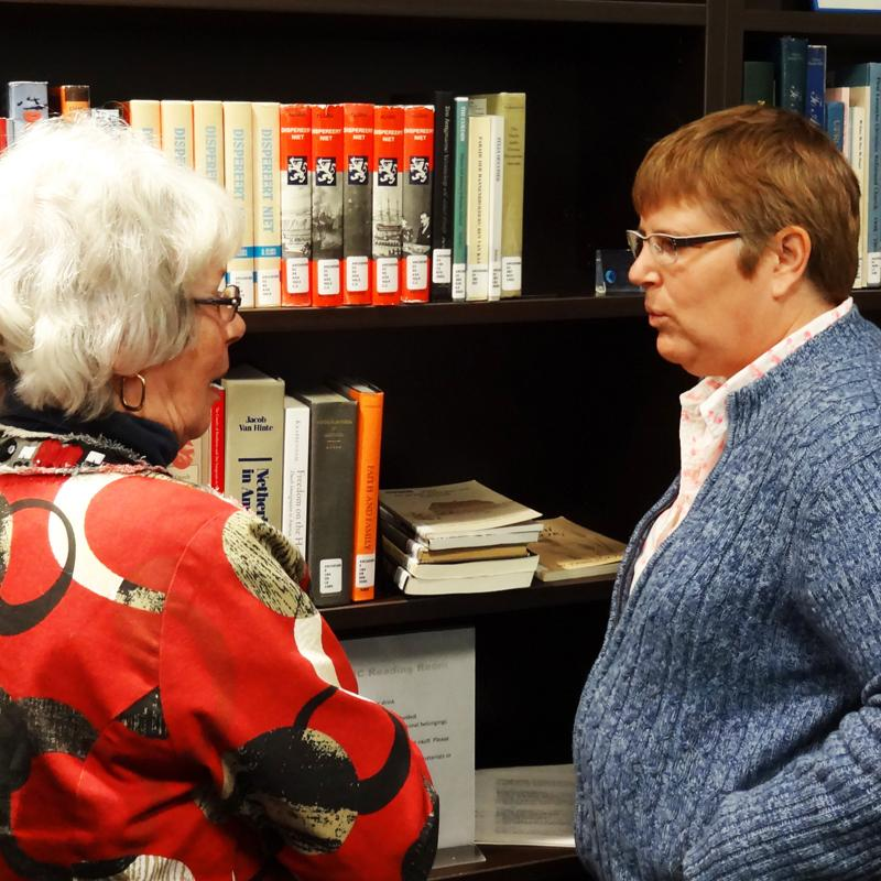 West End CRC member Alyce Oosterhuis (l) and Heritage Collection archivist and library tech Bonita Bjornson.